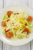 Farfalle with zucchini, tomatoes and cheese Stock Images