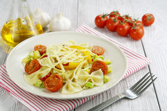 Farfalle with zucchini, tomatoes and cheese Stock Photos