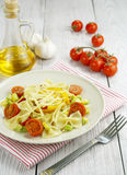 Farfalle with zucchini, tomatoes and cheese Royalty Free Stock Photography