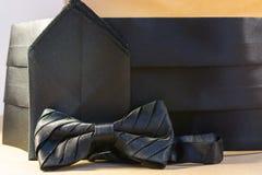 Farfallino nero con un telaio e un fazzoletto Immagini Stock