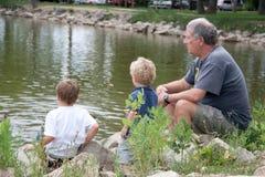 Farfar och sonsöner Arkivfoto