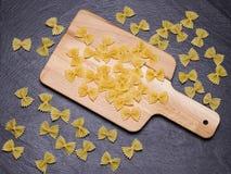 Farfelle on the cutting board Stock Photography
