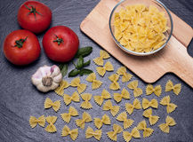 Farfelle on the cutting board Royalty Free Stock Photography