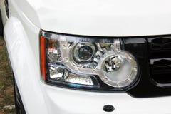 Fari dell'automobile Fari di lusso Automobile Automobile bianca fotografie stock libere da diritti