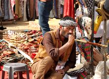 FARIDABAD, HARYANA / INDIA - FEBRUARY 16 2018: A Cobbler Smoking Royalty Free Stock Images