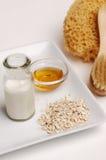 Farina d'avena, latte e miele Fotografie Stock Libere da Diritti