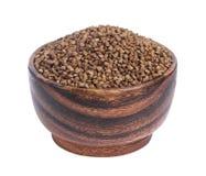 Farina di grano saraceno in ciotola di legno isolata su fondo bianco Fotografia Stock Libera da Diritti