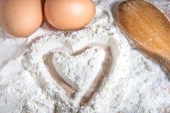 Farina, uova ed amore immagine stock