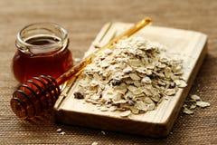 Farine d'avoine et miel photographie stock