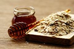 Farine d'avoine et miel photo libre de droits