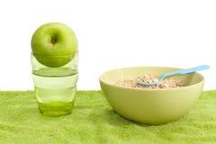 Farine d'avoine, pomme et eau Photos stock