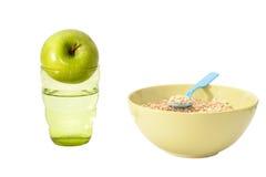 Farine d'avoine, pomme, l'eau Photos stock