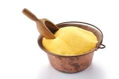 Farinha do milho no potenciômetro de cobre fotografia de stock royalty free