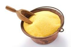 Farinha do milho no potenciômetro de cobre imagem de stock royalty free