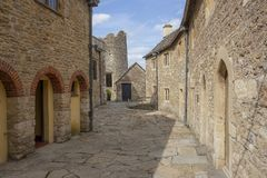 Farleigh Hungerford Castle, Street near priests house. A street in Farleigh Hungerford castle running past the priests house and behind the chapel. Work on the royalty free stock photography