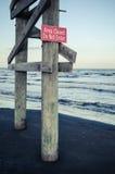 Farlig strand Arkivfoto