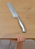 Farligt läge i köket Arkivbilder