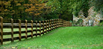 Farm. Beautiful farm with green lawn and wood fence Stock Images