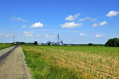 Farm. House and long dirt road Royalty Free Stock Photography