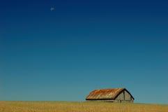 Farm. A farm with blue sky and moon Stock Image
