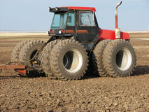 Farm 4-Wheel Drive Tractor. A picture of a red and black four-wheel drive tractor in summer fallow Stock Images