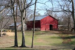 Farm. Featuring a large red barn and storage building stock photography