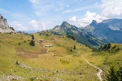Farm in summer in the Swiss Alps. Farm in the alpine mountains in Switzerland royalty free stock photos