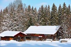 Rustic farm in snowy winter landscape Royalty Free Stock Image