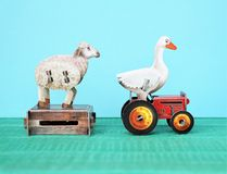 Farm animals, sheep and goose. Small carton figures or childrens toys. blue background and copy space stock photos