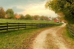 Farm in Autumn. Path leading to farm in autumn stock photography