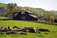 Farm barn. Old farm barn in the hills Royalty Free Stock Photo