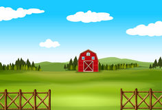 A farm. Barn in a big green farm with fence Royalty Free Stock Photography