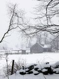 Farm: winter barn fog and snow - v Stock Photography