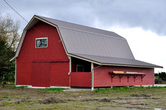 Farm barn with red walls Royalty Free Stock Photography