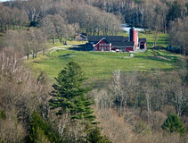 Farm, Barn, Silo surrounded by forest Stock Image