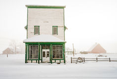 Farm barns and winter snow with country store Royalty Free Stock Photography