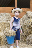Farm boy at the barn Stock Photo
