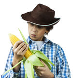 Farm Boy Husking Corn Royalty Free Stock Image