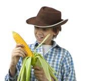 Farm Boy Husking Corn Royalty Free Stock Image