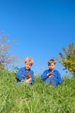 Farm Boys with chickens. Farm boys sitting in grass with chickens stock photography