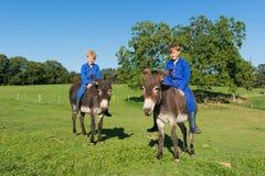 Farm Boys with their donkeys. Farm boys riding on their donkeys stock photos