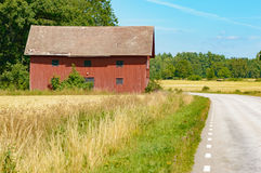Farm building and roadside Stock Photography