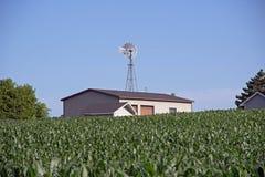 A Farm Building with a Windmill Stock Photos