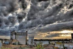 Farm buildings against stormy skies