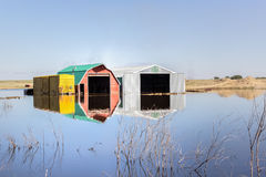 Farm bulidings. Farm buildings in a flooded field Stock Photos