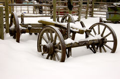 Farm Cart. Wheels and axles from a farm cart left in a snow bank Royalty Free Stock Photos