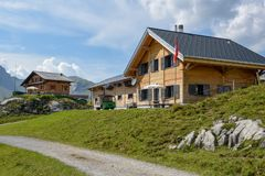 Farm and chalet at Melchsee-Frutt on the Swiss alps. Melchsee-Frutt, Switzerland - 4 August 2018: Farm and chalet at Melchsee-Frutt on the Swiss alps Stock Photography