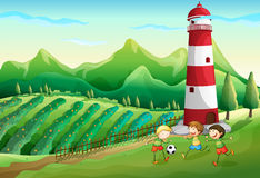 A farm with children playing near the tower Stock Image