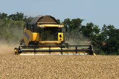 Farm combine harvesting field Royalty Free Stock Photography