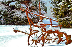 Farm Cultivator in Snow Stock Photography